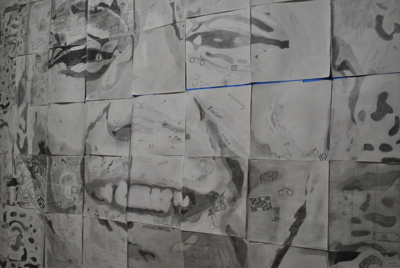 Arts integration mural of a boy's face showing detail in drawing