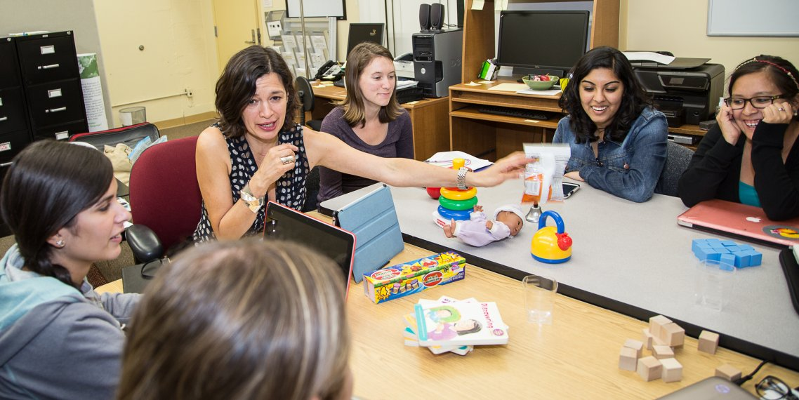 Dr. Natasha Cabrera with her students in the Family Involvement lab