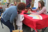 Kelsey Showing Puppets at CYC Meet and Greet
