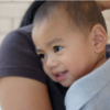 Caregiver holding and comforting child