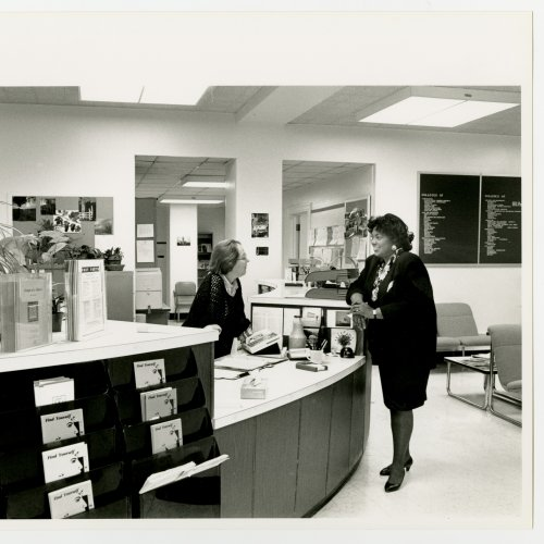 Dr. Vivian Boyd standing at the reception desk speaking to counseling center staff