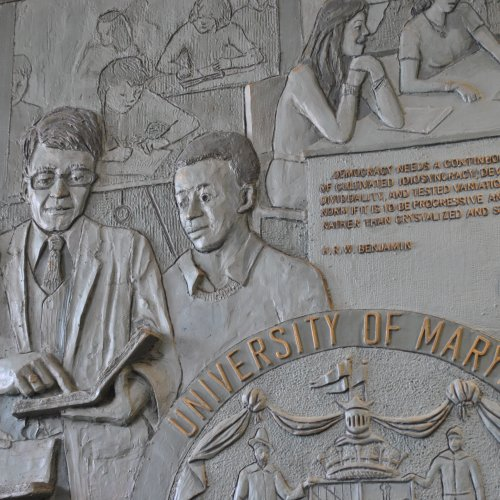 Photo of mural in Benjamin lobby featuring professor and two students